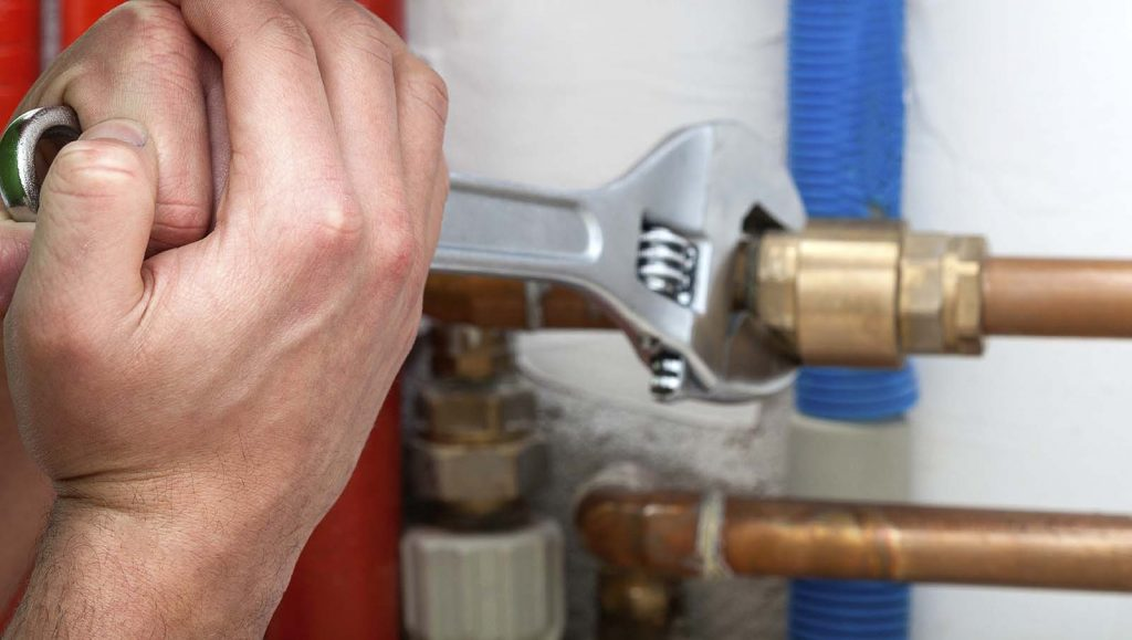 Plumber repairs home gas line leak