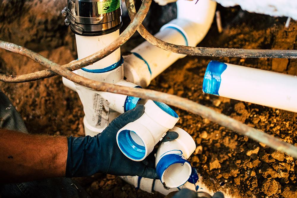 frisco professional plumber replacing sewer line under slab concrete foundation