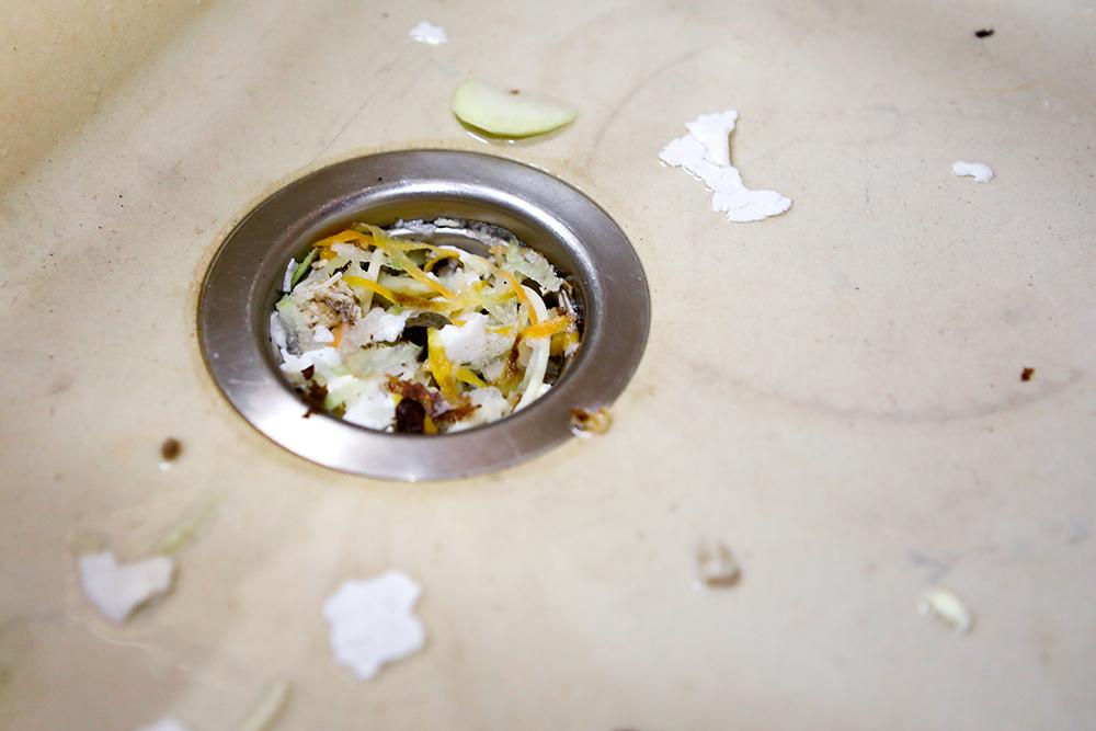 broken garbage disposal food clogged kitchen sink repair